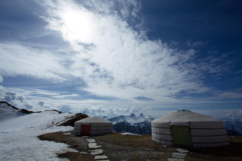 Clouds Over The Rochers-de-Naye. Blue skies and large clouds over the Rochers-de-Naye, a mountain of the Swiss Alps near Montreux of Switzerland. Seen from the stock image