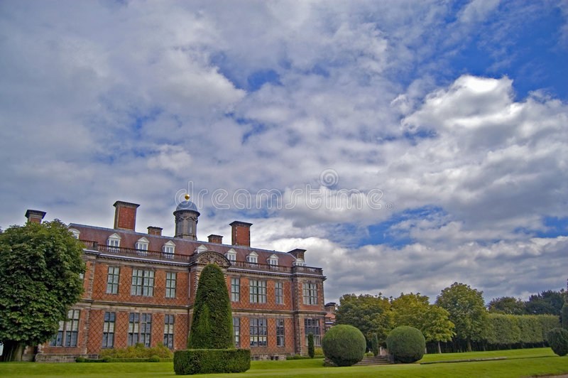 Clouds over sudbury hall. Sudbury hall, sudbury, derbyshire, england, united kingdom royalty free stock photography