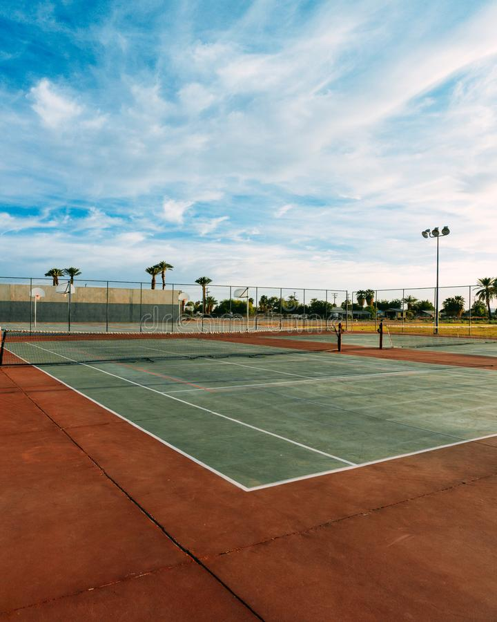 Clouds over the Tennis courts. stock image