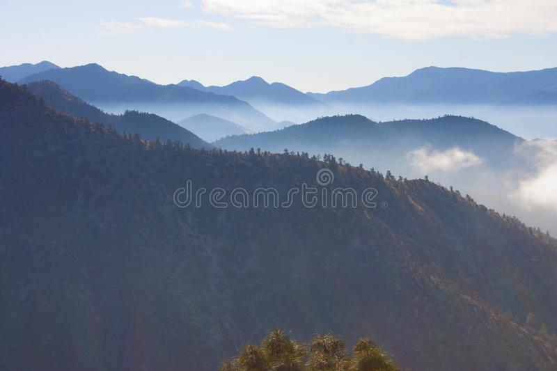 Clouds over valleys in the Sierra Nevada Mountains. California, USA. The Sierra Nevada is a mountain range in the Western United States royalty free stock image