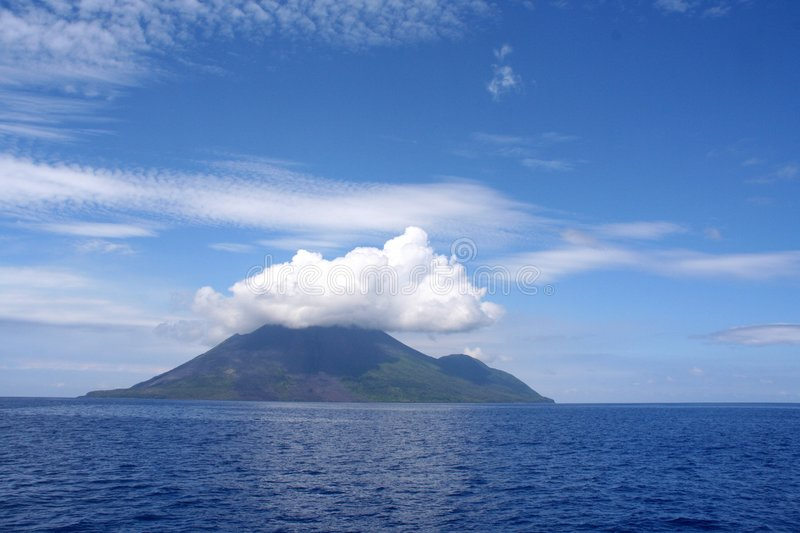 Clouds over volcanic island royalty free stock photo