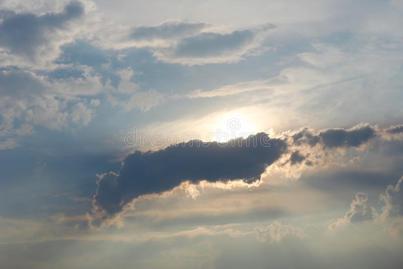 Clouds are partially obscured the sun. stock images