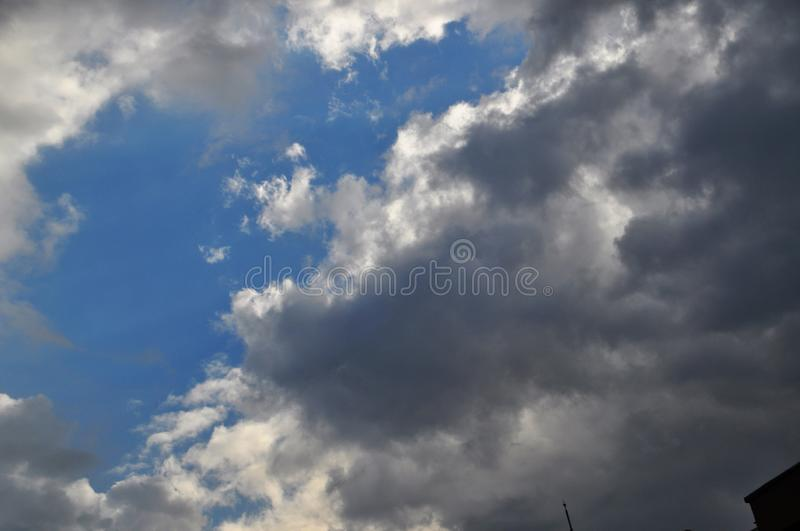 Clouds that are prepared for rain. A song of black and gray clouds in the sky again prepared for a rain and competing for places royalty free stock images
