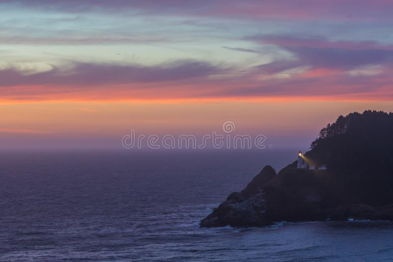 Clouds Reflect Sunset Over Heceta Head stock photography