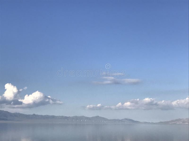 Clouds reflected in the lake stock image