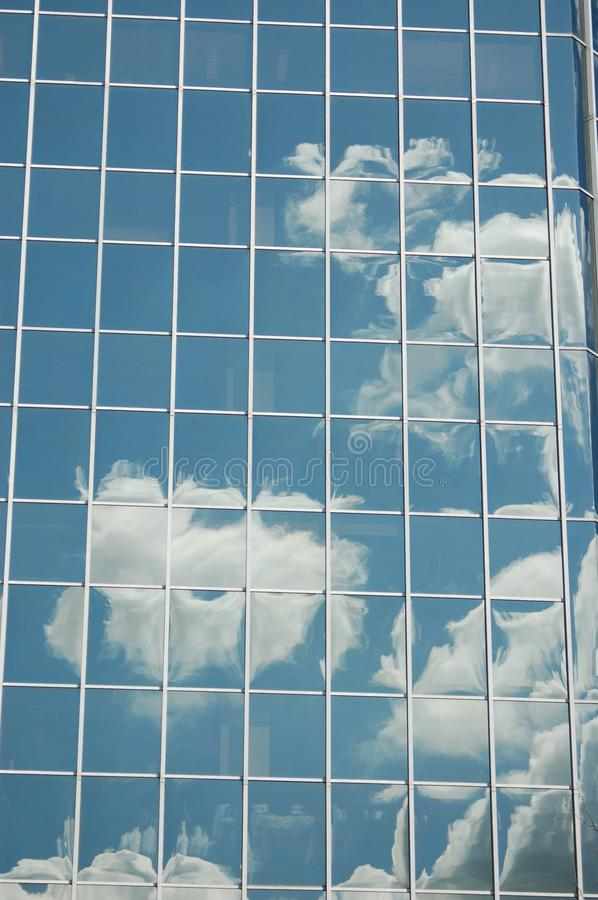 Clouds reflected in an office building`s window, Portland, Oregon stock photo