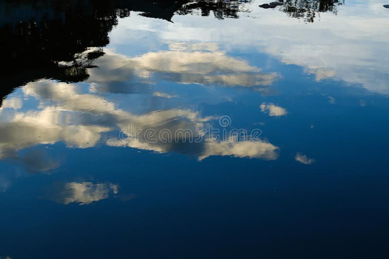 Clouds reflected in the water. An ancient stately home in the historic city center of Jianshui. Yunnan, China royalty free stock photo