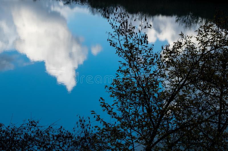 Clouds reflected in water in the Tiber river - Rome, Italy royalty free stock photos