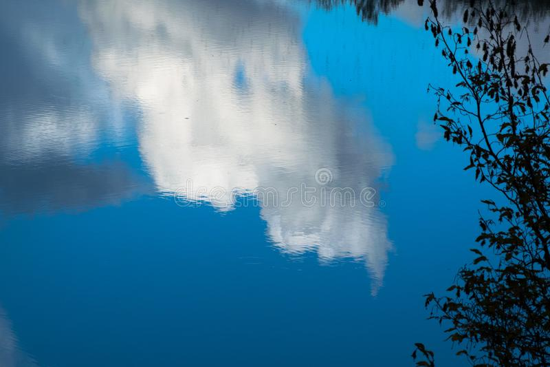 Clouds reflected in water in the Tiber river - Rome, Italy stock images