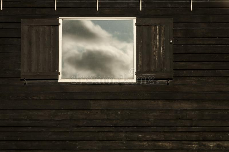 Clouds reflecting in opened old fashioned traditional wood window, Amsterdam, The Netherlands stock images
