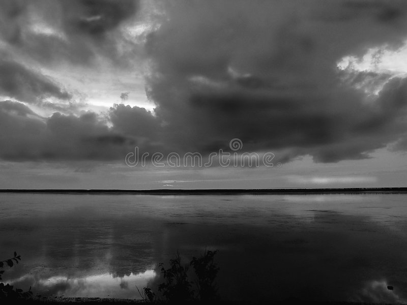 Clouds reflections in black and white royalty free stock photo