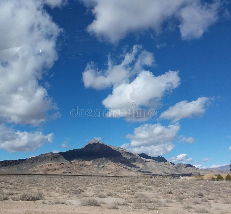 Clouds rising above the desert stock photos