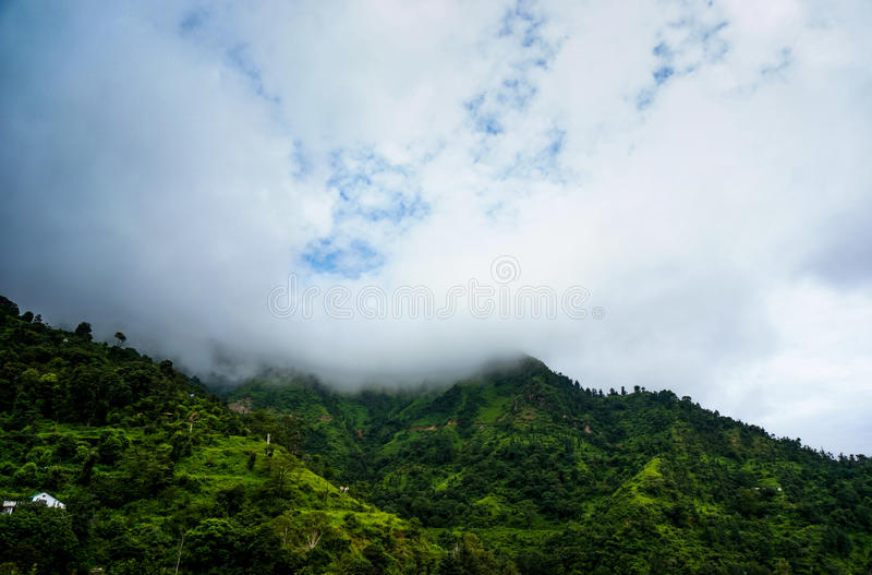 Clouds rolling over the green hills of shimla royalty free stock image