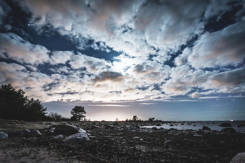 Clouds on the sea. Clouds in summer night over the sea royalty free stock photos