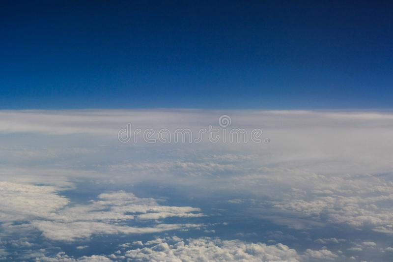 Clear blue sky above the clouds stock image