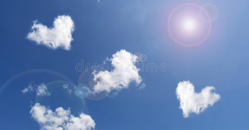 Clouds In Shape Of Heart on Blue Sky background and light flare nature background image for nature background and nature design stock image