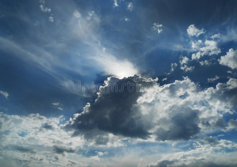 Clouds, silver lining with sunbeams royalty free stock photo