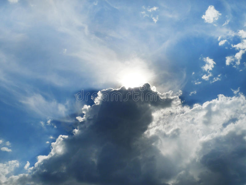 Clouds, silver lining with sunbeams, rising storm clouds stock photos