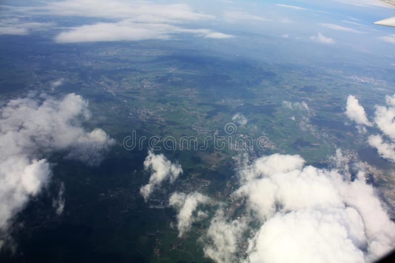 Clouds sky above the earth from airplane royalty free stock photos