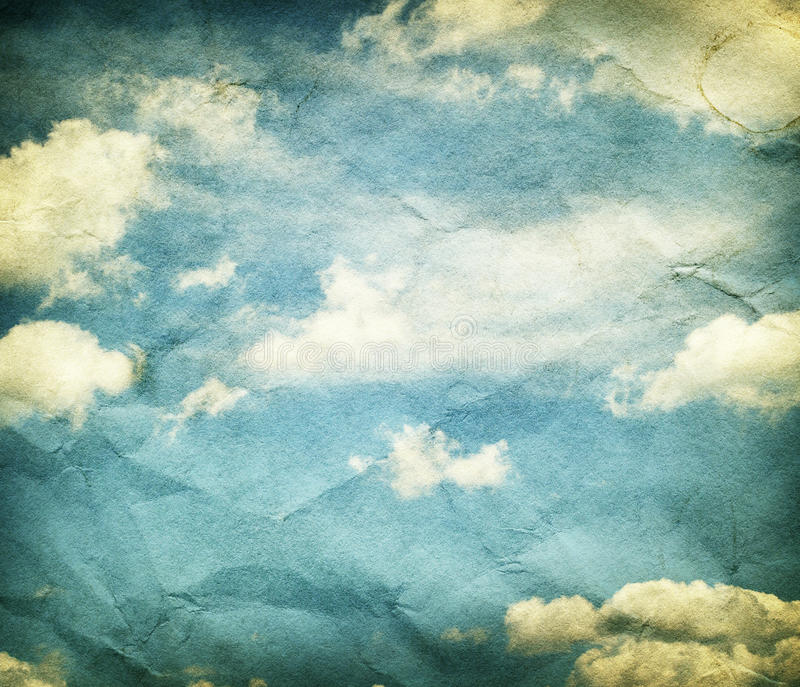 Clouds and sky on crumpled paper texture. royalty free stock image