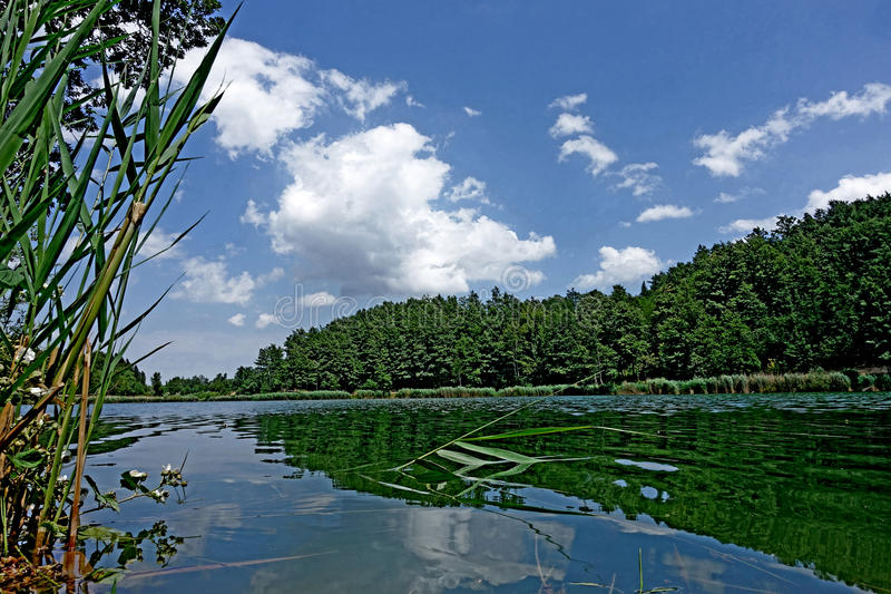 Clouds and sky over lake of Castel dell`Alpi stock photography