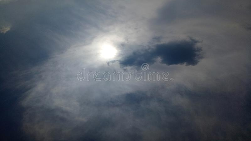Clouds Sky sun shine in dim sky light beautiful background wallpaper. stock image