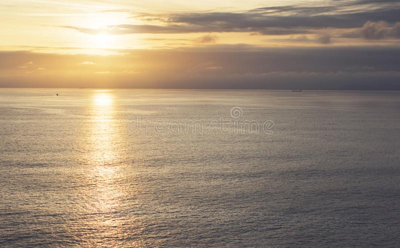 Clouds sky and sunlight sunset on horizon ocean. Silhouette person on background seascape dramatic atmosphere rays sunrise. Relax. View waves water sea, mockup stock image