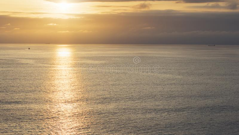Clouds sky and sunlight sunset on horizon ocean. Silhouette person on background seascape dramatic atmosphere rays sunrise. Relax. View waves water sea, mockup royalty free stock photos