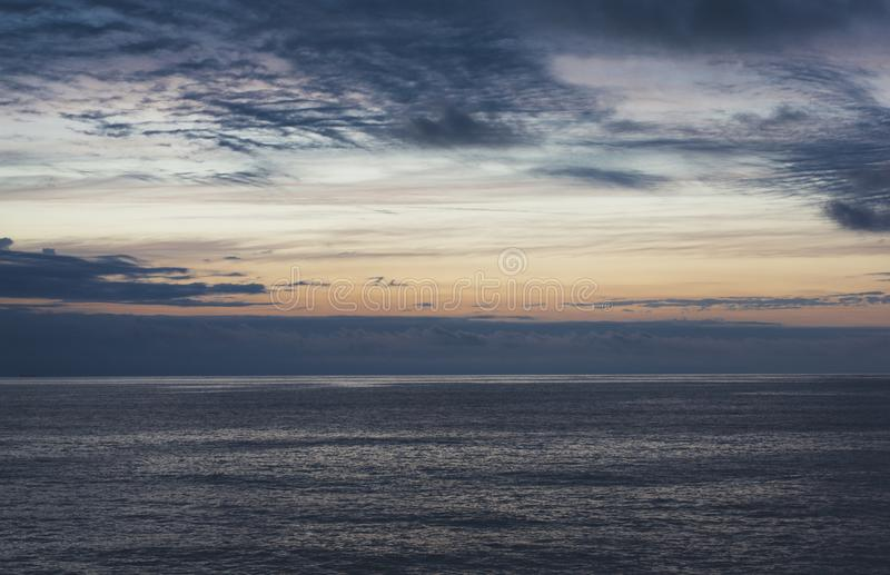 Clouds sky and sunlight sunset on horizon ocean. Silhouette person on background seascape dramatic atmosphere rays sunrise. Relax. View waves water sea, mockup stock photos