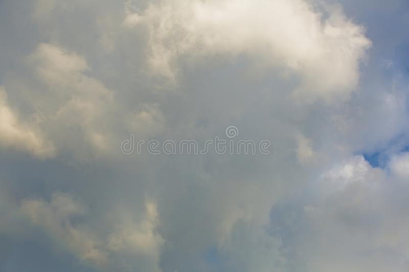 Clouds in the sky when the weather changes. Picturesque textured clouds in the sky at the daytime royalty free stock photography