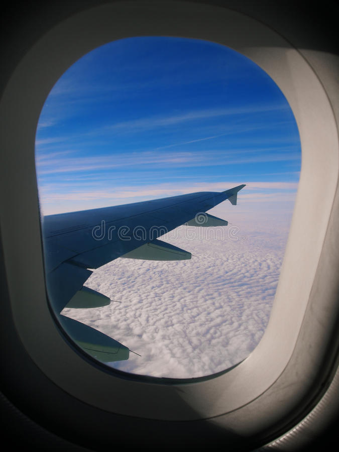 The clouds, sky and the wing royalty free stock photo
