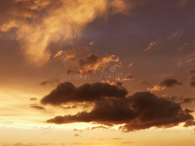 clouds skysolnedgång arkivfoton
