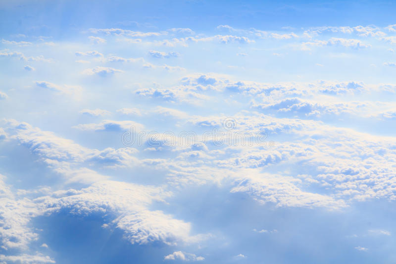 Clouds and smoke horizontal. White fluffy clouds mixed in with white smoke from bushfires below, against a blue sky royalty free stock photography
