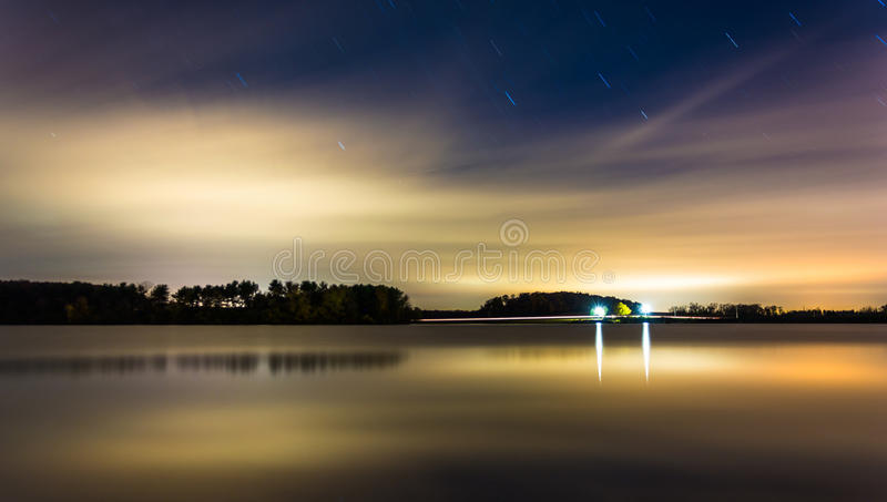 Clouds and stars moving over Long Arm Reservoir at night, near H royalty free stock photography