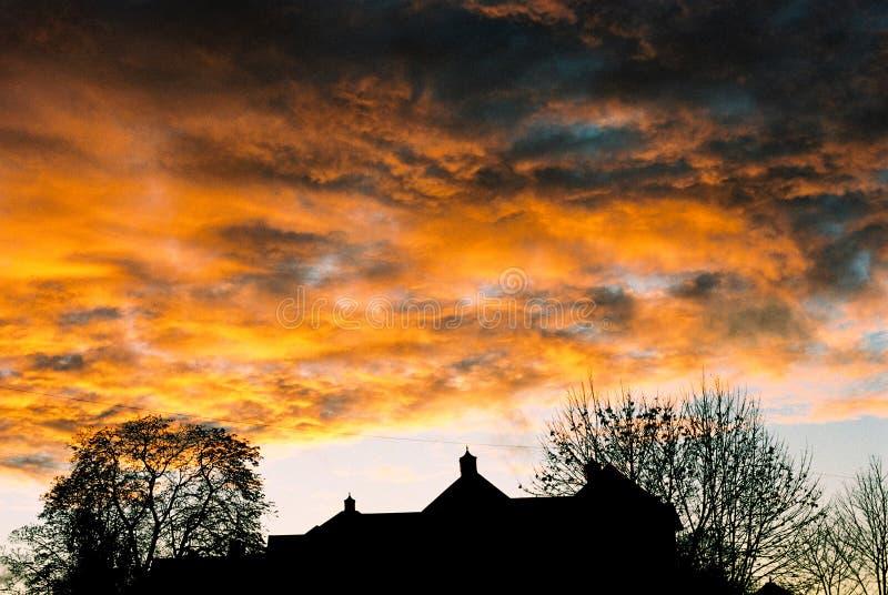 clouds stormig solnedgång arkivbild