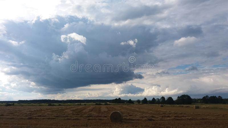 Clouds and stubble stock photography