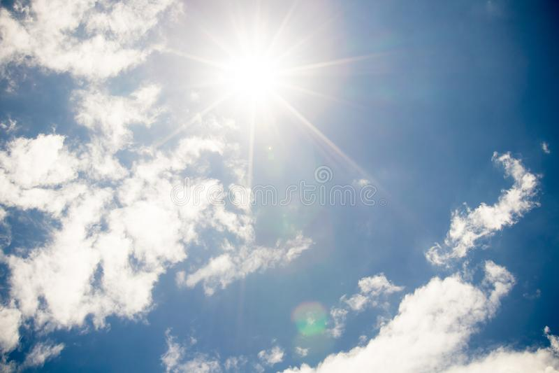 Clouds and sun with blue sky background.Strong sun and sky. Cloudy sky and blue clear sky clouds and sun background stock image