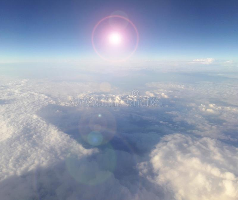 Clouds and sun scenery in the atmosphere with sun beams. Clouds and sun scenery in the atmosphere being blue celestial harmony above the Earth sun beams royalty free stock photos