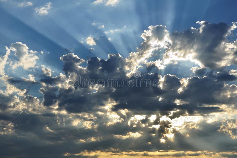 clouds sunbeams arkivbilder
