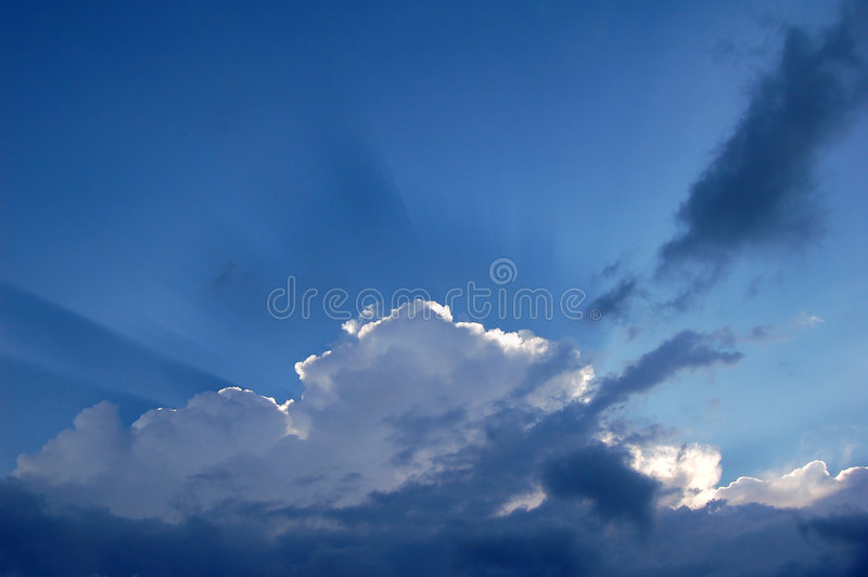 Clouds and Sunbeams stock photo