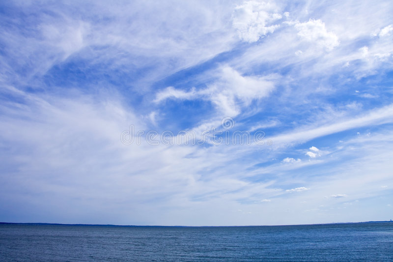 clouds sunlit arkivfoto