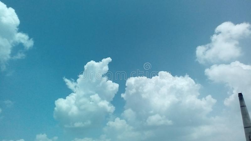 Clouds in the a Sunny day with the Sun rays falling on in style. 2018 royalty free stock images