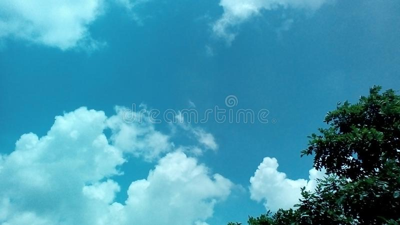 Clouds in the a Sunny day with the Sun rays falling on in style. 2018 royalty free stock photo