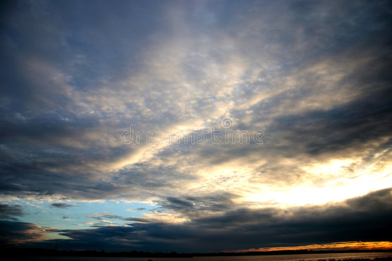 Clouds in the sunset royalty free stock photo