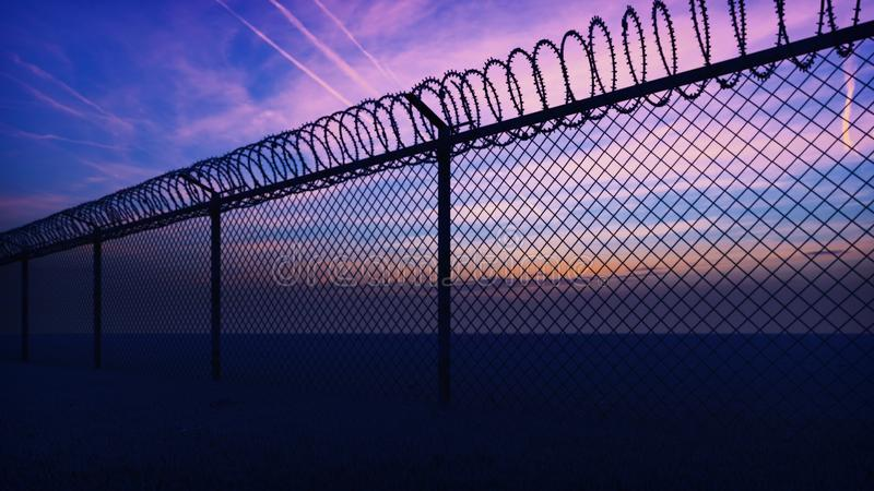 Clouds and a sunset can be seen through the metal prison fence with barbed wire. 3D Rendering royalty free stock photos