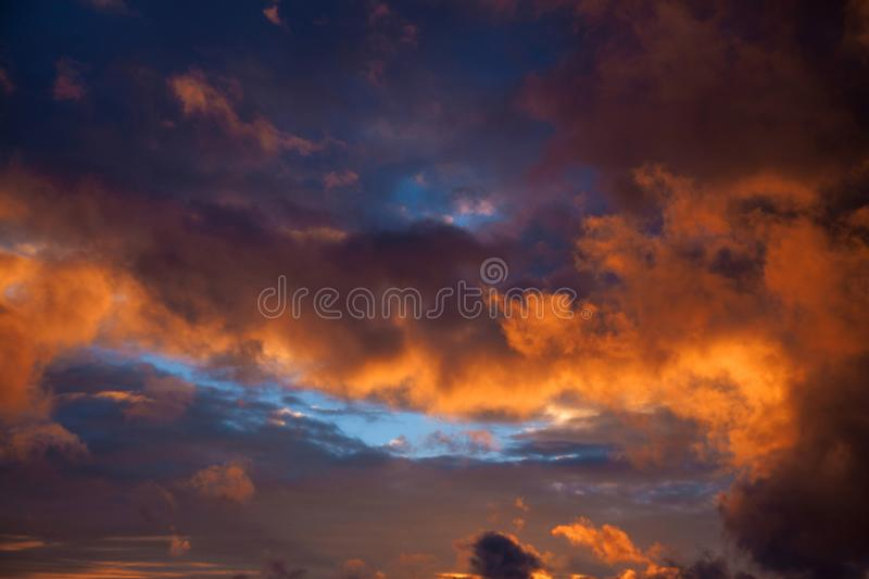 Clouds, sunset. The sky after the rain. Dramatic sky. Orange and yellow clouds. stock photography