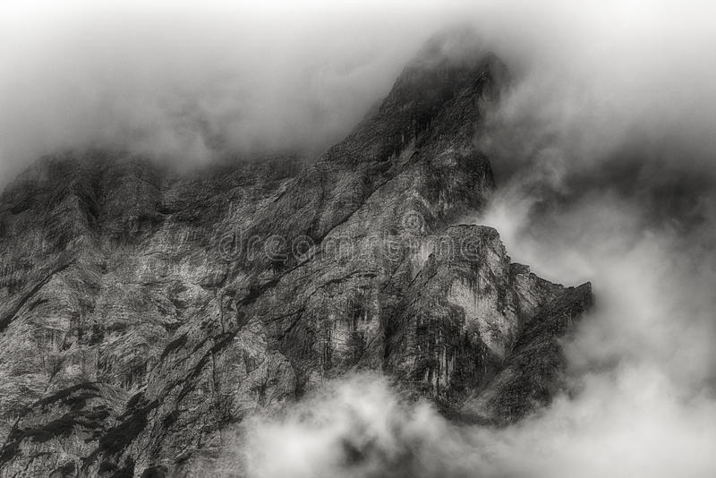 Clouds on the top of mountain royalty free stock images