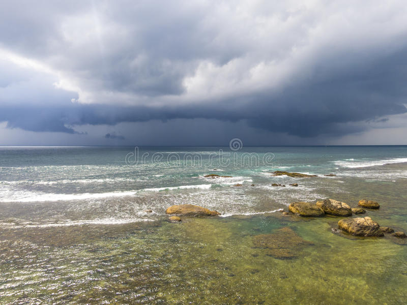 Clouds under the beach in Galle. Srilanka royalty free stock image