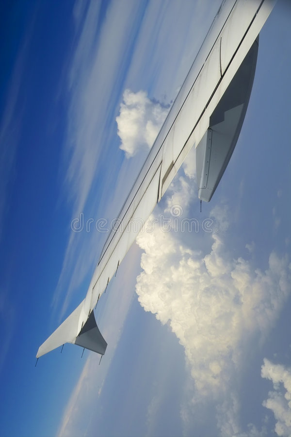 Clouds under the wing stock photos