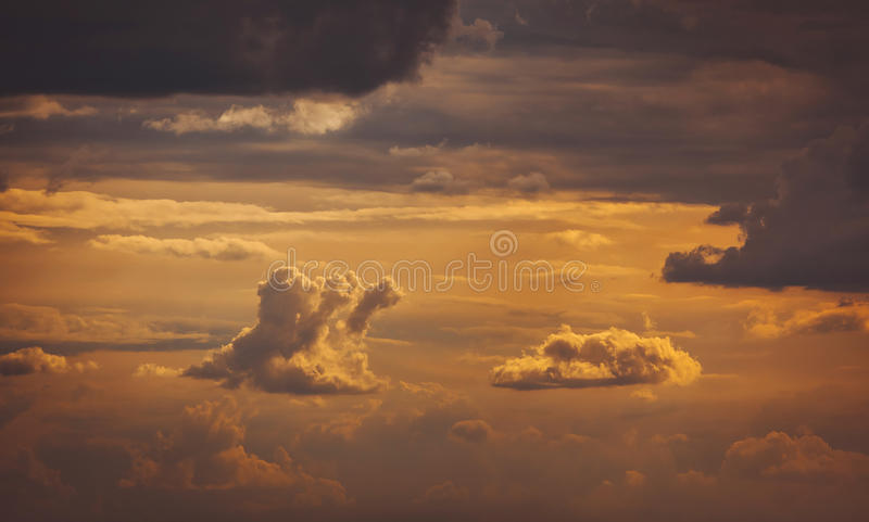 Clouds in the unusual form of the sun-lit at sunset. View royalty free stock image